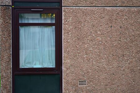 scottish culture: Old window is closed in a brick wall. Stock Photo