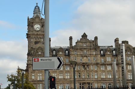 waverley: Arrow symbol on a pole in front of a historic building. Editorial