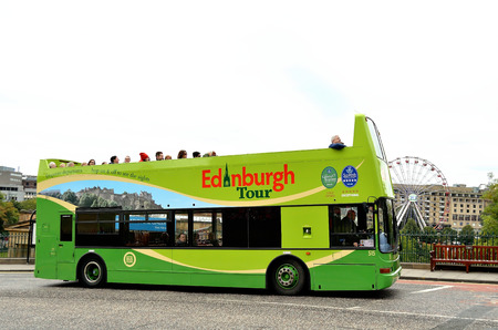 lothian: Tour buses taking tourists around the Scottish capital Edinbrugh. Editorial