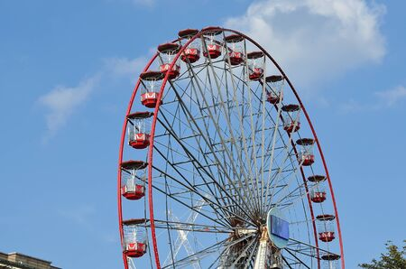 scot: Ferris wheel and scot monument on clear blue sky. Editorial