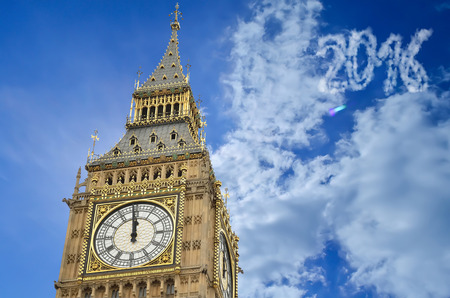 attraktion: 12 OClock in Big Ben, 2016 in clouds is written on sky using image processing software. Stock Photo