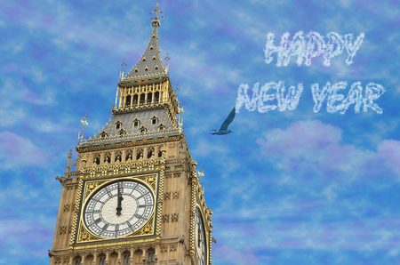 12 oclock: 12 OClock in Big Ben, 2016 in clouds is written on sky using image processing software. Stock Photo