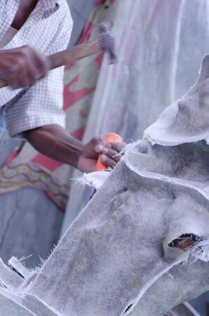 craft on marble: A sculptor is working on a white marble.A hammer was used. Stock Photo