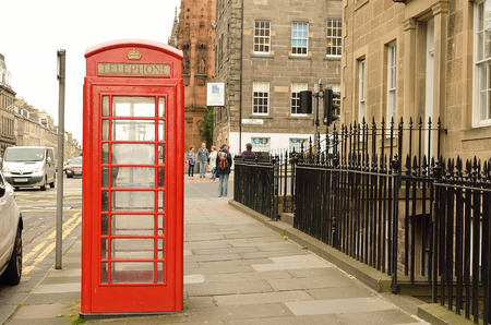 red telephone: British red telephone boxes, depiction of English heritage.