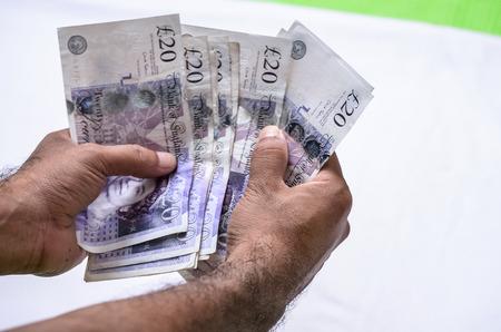 pound: Counting Britain pound money.