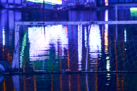 In a festival area was decorated by led light.. Decoration of festival lighting is reflected on water. Stock Photo