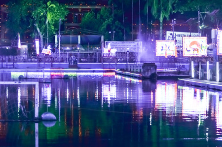 reflected: Festival lighting is reflected on water. Stock Photo