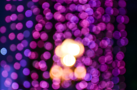 violated: Photo showing a defocused light. Defocused violated color light in a public place in public festival.