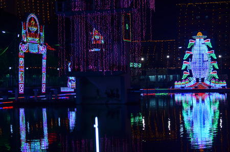 led lighting: In a festival area was decorated by led light.. Decoration of festival lighting is reflected on water. Stock Photo