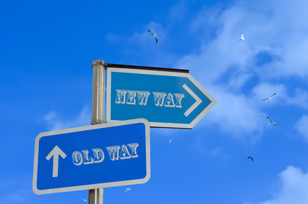 new direction: Old way new way direction on sky background
