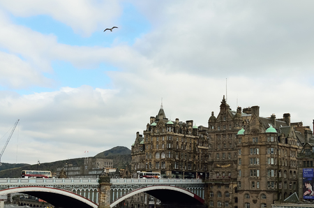 waverley: North bridge and nearby buildings at Edinburgh. The bridge is located on the top of the railway station, Waverley. Stock Photo