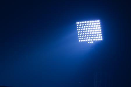 soccer: Stadium floodlights against a dark night sky background.