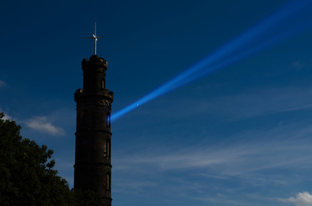 lothian: Nelson Monument on Calton Hill, Edinburgh, Scotland. It was built between 1807 and 1815. To respect Vice Admiral Horatio Nelsons victory at the Battle of Trafalgar. Light beam is digitally made.
