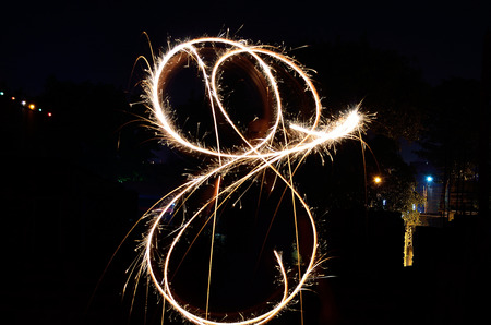 sparklet: Sparkling fireworks in black background.