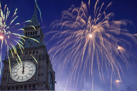 12 o'clock: 12 OClock in Big Ben, Fireworks are displayed on sky to celebrate new year.