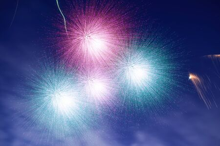 dia y noche: Close-up of fireworks in a night sky. Five photograph are merged in photo processing software. It consist 12 layers.