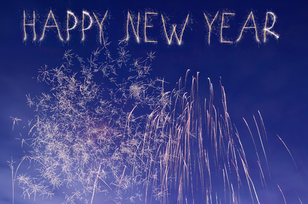text space: Close-up of fireworks in a night sky. In new year eve. Happy new year text.