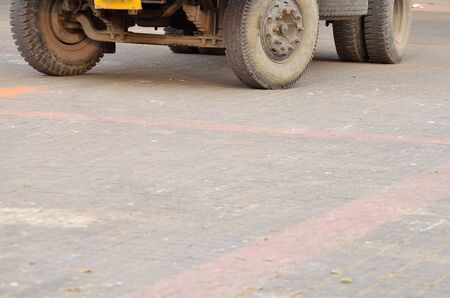 waited: Truck is moving in a road.