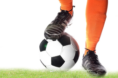 pelota de futbol: Boy is receiving soccer ball in white background.