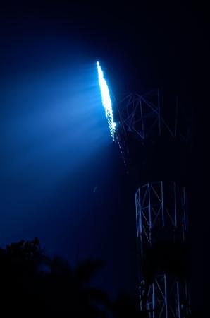 floodlights: Close-up of stadium floodlights against a dark night sky background