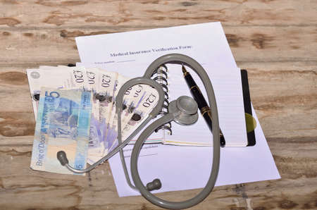 fillup: British currency for health insurance form fill-up.