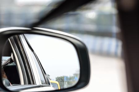 rear view mirror: Rear view mirror reflecting car. Stock Photo