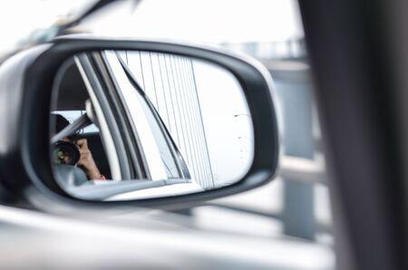 rear view: Rear view mirror reflecting car. Stock Photo