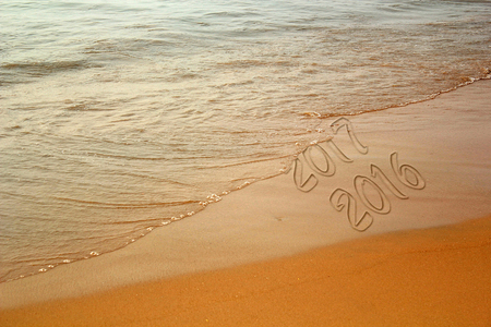 morphing: Bringing of Year 2017 in the beach. The text 2017 and 2016 are written using image processing software.