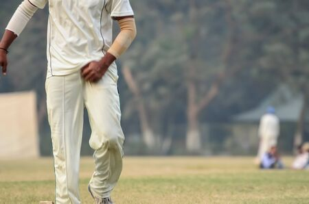 Boy is playing cricket on Maidan area in Kolkata, India. Maidan is a public place and anyone can capture photograph. I took the advantage of it and took the photograph.