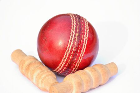 bails: Cricket ball and bails with a shadow on a white background.