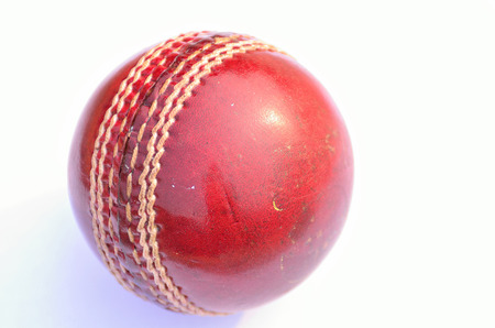 leather ball: Cricket ball in isolated on white. Classic red leather ball. Stock Photo