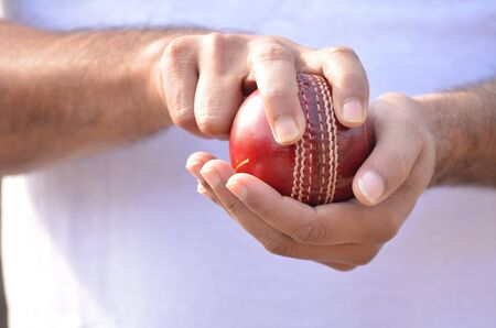 grip: Boys are playing cricket. Fast bowling grip.
