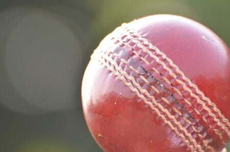 red leather: Classic red leather cricket ball. Stock Photo