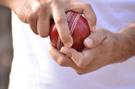 grip: Boys are playing cricket. Spin bowling grip.