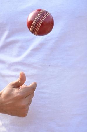 bowler: Cricket bowler juggling ball. Stock Photo
