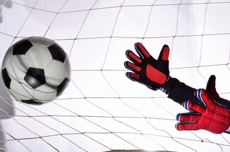 Soccer goalkeeper training in white ball.