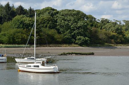 landscape mode: Boat floating on sea.