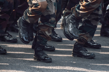 Soldiers in camouflage dress marching. Soldiers Marching In An Army Parade. Stock Photo