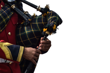 bagpipe: Blowing into bagpipe, portrait.