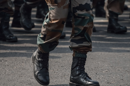 marching: Soldiers in camouflage dress marching. Soldiers Marching In An Army Parade. Stock Photo