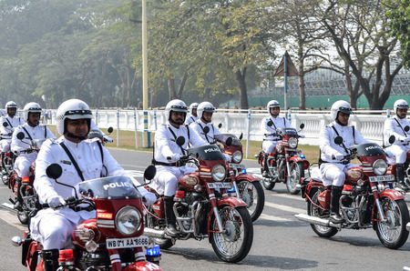 a white police motorcycle: During republic day practice Calcutta police practice their parade.
