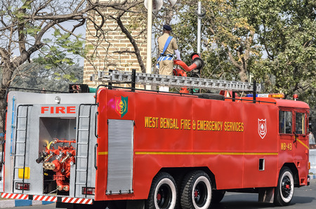 fire brigade: Indian fire brigade is running in road. West Bengal fire brigade.