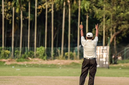 outfield: Boys are playing cricket on Maidan area at Calcutta, India. Maidan is a public place and anyone can capture photograph. There is no ticket, anyone can see. There is open ground, no stadium there no entry point. Editorial