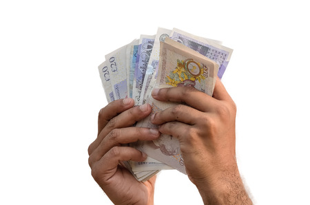 Man counting English Pound in white background. Stock Photo