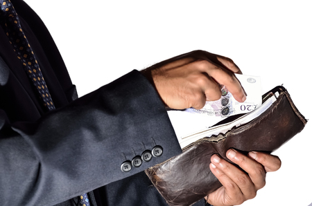 one person only: Man counting currency to give another in white background Stock Photo