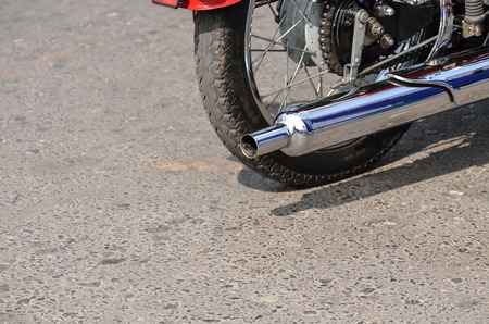 exhaust: A rear view of a motorcycle exhaust