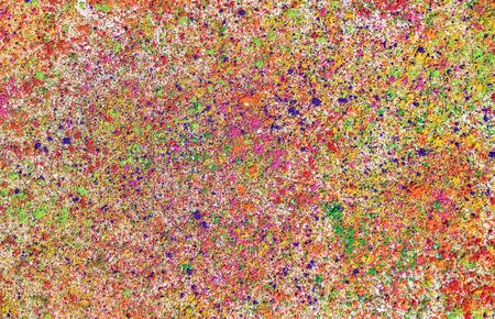 hindus: Colorful background with Holi powder. Holi is a festival celebrated in spring by Hindus, Sikhs and others, people throwing colored powder and colored water at each other. Stock Photo