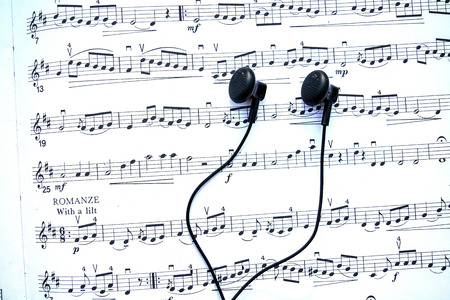 distorted image: Headphones and musical notes. Stock Photo