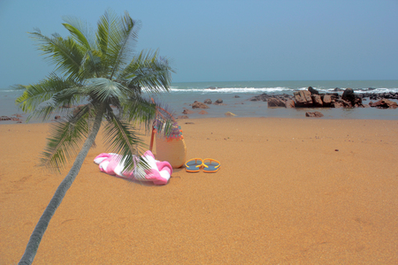 beach towel: Empty beach. Towel,beach bag and slipper in beach Stock Photo