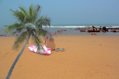 sandal tree: Empty beach. Towel,beach bag and slipper in beach Stock Photo